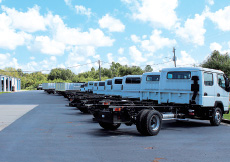 white trucks parked in a row